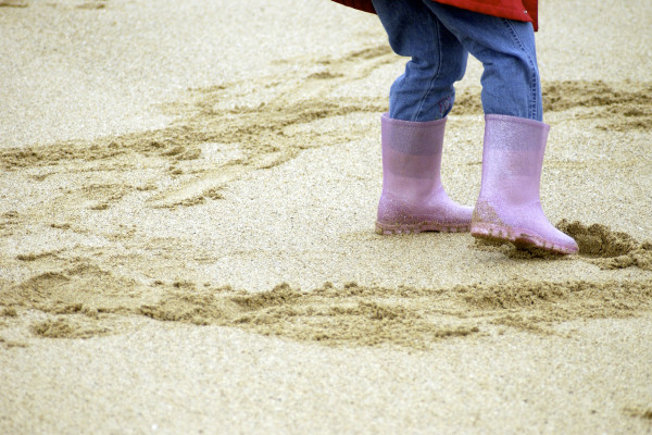 child's welly boots on beach