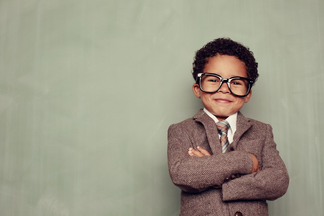 A young boy and knowledge whiz is ready to teach the class. Just add smart copy for the perfect concept.