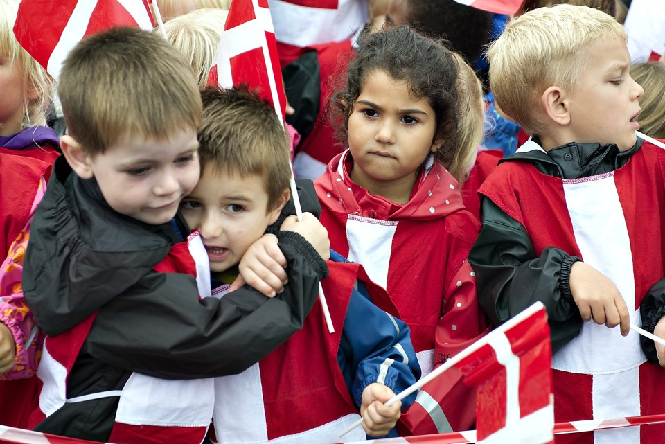 Children holding Danish flags watch as Denmark's Crown Prince Frederik (not pictured) attends a sailing match race at the Nations Cup in Middelfart August 8, 2013. REUTERS/Henning Bagger/Scanpix Denmark (DENMARK - Tags: POLITICS ROYALS SPORT YACHTING ENTERTAINMENT)     ATTENTION EDITORS - THIS IMAGE HAS BEEN SUPPLIED BY A THIRD PARTY. IT IS DISTRIBUTED, EXACTLY AS RECEIVED BY REUTERS, AS A SERVICE TO CLIENTS. DENMARK OUT. NO COMMERCIAL OR EDITORIAL SALES IN DENMARK. NO COMMERCIAL SALES - RTX12DSF